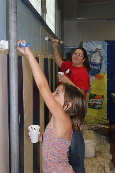 by: Photo by Tony Ahern - Tegen Lantz, 9, helps paint a wall at the Kids Club along with Charitie Gamble, in the background.