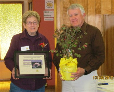 by: Submitted Photo - Betty Hale receives the Volunteer of the Year award from Kevin Hormann, Juniper Junction Relief Nursery Board chairman.