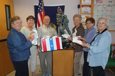 by: Photo by Susan Matheny - Members of Alpha Omicron Sorority presented a donation of new socks to returning veterans service officer Tom Weise last week, to be given away at the upcoming Central Oregon Stand Down. Pictured from left are, Nancy Jolstead, Sharon Blackman, Tom Weise, Janet Rose, Bev Haworth, and Louise Muir. The donation was part of the sorority's Hope for Heros program.