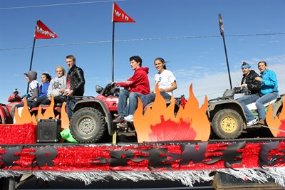 by: Photo by Susan Matheny - Seniors won the homecoming float contest with an entry featuring a semi hauling flaming ATVs.