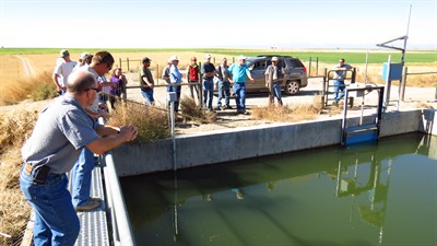 by: Photo courtesy of Jefferson County SWCD - The Oct. 2 tour stopped at the surge pond off of Fern Lane, and witnessed the