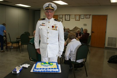 by: Photo by Susan Matheny - Retired Navy commander Ellis Skidmore wore his original officer's uniform to celebrate his 91st birthday with bridge club members at the Jefferson County Senior Center.