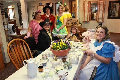 by: Photo by Susan Matheny - Madras Vision Source's Alice in Wonderland theme won the best overall award. Dr. Jessica Tegen, dressed as Alice, sits at the Mad Hatter's Tea Party.
