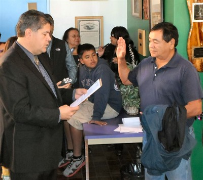 by: Photo by Duran Bobb - John Halliday, Warm Springs Bureau of Indian Affairs superintendent, swears in Alfred Smith Jr., of Warm Springs, as the new chief of the Wasco tribe on Monday. Smith received the most votes from Wasco voters on Oct. 30.