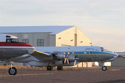 by: Photo by Holly M. Gill - Aero Air, of Hillsboro, has purchased the Butler Aircraft firefighting operation, including DC-7s, at the Madras airport. The local operation, which will be called Erickson Aero Tanker, will also house a fleet of MD-87s – the next generation of air tankers.