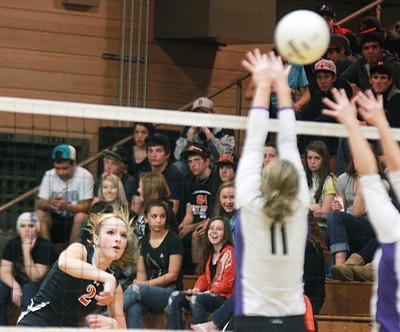 by: Billy Gates/The Pioneer - Culver's Gabrielle Alley watches her attack sail by a pair of Portland Christian blockers during the Bulldogs' four-set win against the Royals in the Class 2A OSAA first round playoffs Saturday in Culver. Alley had a team-high 19 kills.