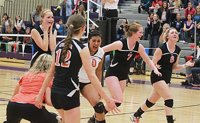 by: Billy Gates/The Pioneer - The Culver volleyball team runs to the baseline after scoring the final point to win the Class 2A state volleyball championship Saturday night at Ridgeview High School in Redmond. The Bulldogs beat the Days Creek Wolves in five sets to win the title.