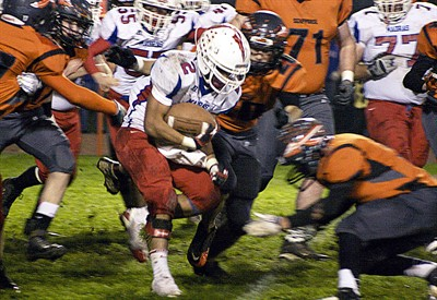 by: Photo by Kyle Boggs/St. Helens Chronicle - Madras running back Joe Hisatake chews up yardage during the Buffs' 50-8 loss to Scappoose in the first round of the Class 4A football playoffs Friday night in Scappoose.