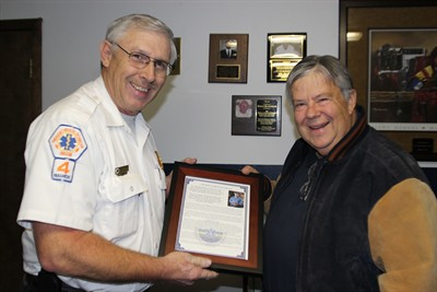 by: Photo By Holly Gill - Dr. Douglas Lieuallen, right, is presented with the Emergency Medical Services Director of the Year award by Jefferson County EMS Chief Don Heckathorn.