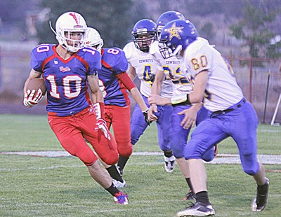 by: Billy Gates/The Pioneer - Madras senior Devin Ceciliani, pictured here running back the opening kickoff against Crook County for a touchdown earlier in the season, was named to the first-team all-Tri-Valley Conference football team at three positions – wide receiver, defensive back and kick returner.