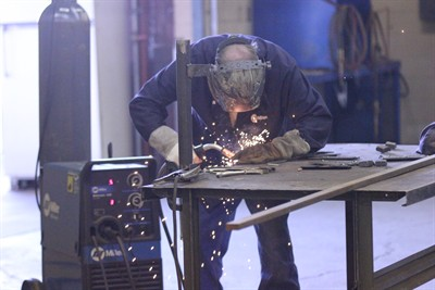 by: File Photo - A student in COCC's spring welding class works on a project.