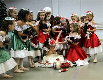by: Submitted Photo - Dancers console Clara after her nutcracker toy breaks in