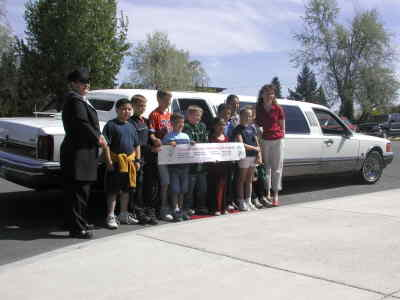 by: Photo By Susan Matheny - Culver Principal Stephanie Garber took 10 Culver Elementary School students to lunch at Papa's Pizza in Redmond in a limo May 23, to reward them for logging the most miles around the school track.