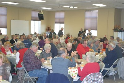 by: Submitted photo - The Crooked River Ranch Chapel's community center was filled on Nov. 15, for the annual pre-Thanksgiving feast, put on by the Ranch Seniors.