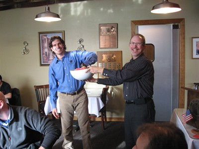by: Submitted Photo - Doug Maragas, left, of Maragas Winery, draws the winning raffle tickets at the Kiwanis meeting, from a bowl held by Kiwanian Bob Jones.