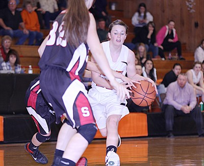 by: Pioneer file photo - Culver point guard Sara McKinney tries to drive past a defender during a game last season. This year, McKinney will start the year a little later than everyone else due to a back injury.