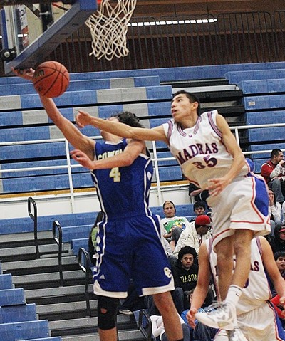 by: Pioneer file photo - Madras' Jhaylen Yeahquo blocks the shot of a Crook County player last season. Yeahquo, a senior, is expected to be one of the Buffs' big players this season. Madras opens the season Friday against Crook County in Madras.
