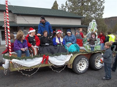 by: Photo by John Bowler - The Crooked River Ranch Chapel choir prepares for the start of the Olde-Fashioned Christmas Parade on Saturday. In addition to the parade, the day's activities included an Artists and Crafters Show.