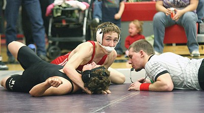 by: Billy Gates/The Pioneer - Madras' Brandon Hawes gains a top position on a North Lake wrestler during Saturday's Central Oregon Officials Open wrestling tournament at Mountain View High School in Bend.