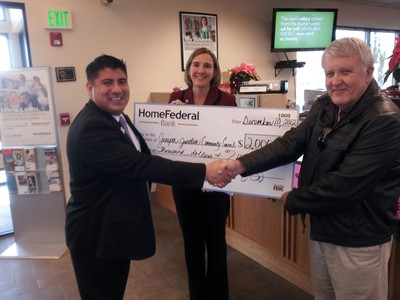 by: Submitted Photo - Submitted Photo A donation check was recently awarded to Kevin Hormann, Juniper Junction Community Council chairman, at right, by A.J. Losoya, Home Federal Bank vice president, on left, and Tena Jackson, Home Federal Bank Madras operations manager.