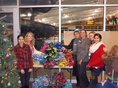 by: Submitted Photo - Delivering blankets are, from left, Interact Club member Stephanie Olivera, Home Federal Bank employees Teri Drew, Linna Shepherd, and Tena Jackson, and Interact Club members Alyssa Booren and Melissa Olivera.