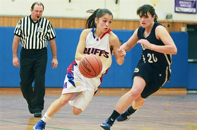 by: Billy Gates/The Pioneer - Madras' Mariah Stacona drives past a Bend defender during the Buffs' 48-44 loss to the Lava Bears on Dec. 18 at Madras High School. Stacona scored 31 points against the Lava Bears.