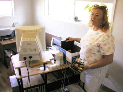 by: Photo By Troy Foster - Peggy Adams, volunteer coordinator of the Determination Social Center, moves into her new office at 208 N.E. Cowden St. Adams says the self-run, independent support group is working hard to survive despite a falling out with the county and BestCare.