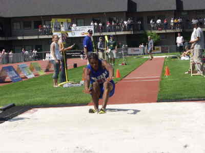 by: Photo By Brian Liebenstein - Dominique Easterling landed another triple jump state championship for Madras and himself on Saturday at the Oregon 3A state meet. He lands one of his jumps above.