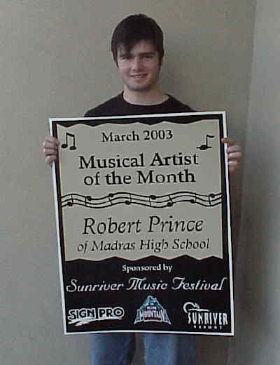 by: Submitted Photo - Robert Prince with award.