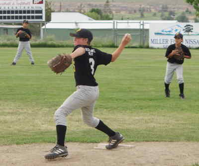 by: Photo By Brian Liebenstein  - With Josh Ross turning in a strong relief job as pitcher after a minor injury to Turner Gill, the Pirates of Insurance Mart held off the Warm Springs Majors team on Saturday.