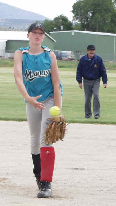 by: Photo By Brian Liebenstein - Potential Junior division all-star Krista Haugen throws for the Madras team in a Saturday win over Warm Springs in the 13-14 age group of Little League softball.