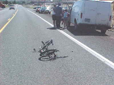by: Photo contributed - The twisted bike of one of the accident victims sits in the roadway.