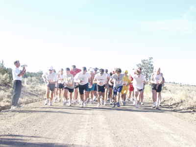 by: Photo By Madras Pioneer - Competitors leave the starting line of the Todd Beamer Memorial Run, a 10-kilometer and ride-and-tie race on July 4. Former Madras High race Mike Manning won.