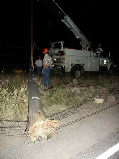 by: Submitted Photo  - CEC crewmen work to upright a power pole that was sheared off by a car July 21.