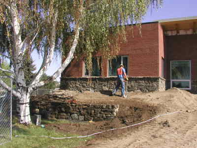 by: Photo By Susan Matheny - New stonework goes up in front of the Living Center during Mountain View Hospital's renovation project.