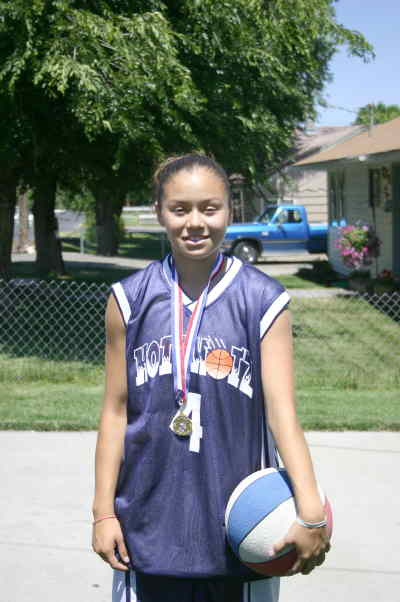 by: Photo By Christina M. Crockett - Brianna Stacona of Madras played as the sstarting point guard for the 13-Under Washington HotShotz team. Stacona was instrumental in aiding the team to a national championship title in Phoenix on June 25-July 1. Stacona and her family are grateful for the aid given to them by the local community, which made the trip to Arizona possible.