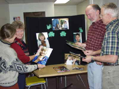 by: Photo By Susan Matheny - Lynn Breese, left, Kathy Stevenson, Bing Bingham and Clint jacks check out the photos of tri-county 4-H kids which will be featured at a special exhibit at Willow Creek Book Store on Saturday, Nov. 13.