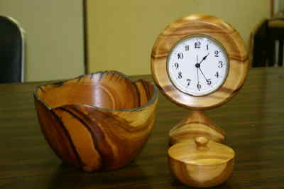 by: Photo By Susan Matheny - Juniper wood bowl and clock by Ted Freeman.