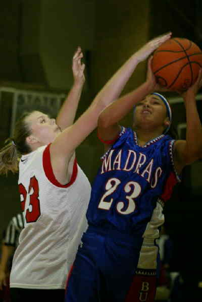 by: Photo By Christina M. Crockett - The Madras girls basketball program returns four players to the varsity team this year, as well as three talented freshmen, including Erika Miller (23), who played with the Buffs in a jamboree at Sisters on Monday night against the Outlaws and Mountain View (shown above).