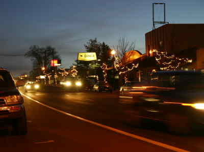 by: Photo By Holly M. Gill - Christmas lights brighten the downtown area on Fifth Street just after dusk on a recent evening.