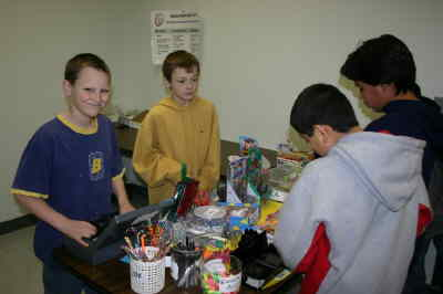by: Photo By Susan Matheny - Sixth-graders Phillip Crask, left, and Jordan Allbritton wait on customers at The Busy Buffalo school store at Jefferson County Middle School. The venture helps students develop skills for possible future careers.
