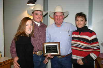 by: Photo By Susan Matheny - Tom Green was recently named the Jefferson County Livestockman of the Year. Pictured from left, the Green's son and his wife, Sammee and Tony Green, who are partners in the feedlot business with Tom and Susie Green.