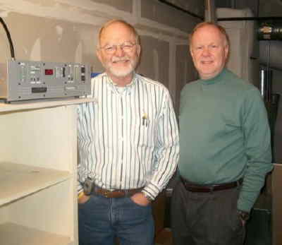 by: Submitted Photo - John Curnutt, left, and Dan Toms stand by the transmitter for the low power FM station, KMAB-LP.