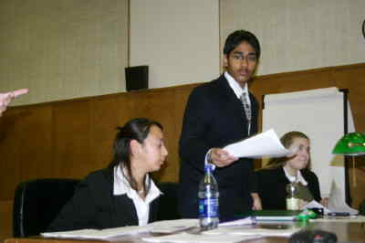 by: Photo By Susan Matheny - Mock Trial defense team of Karina Romero, left, Amar Patel and Pam Ward.