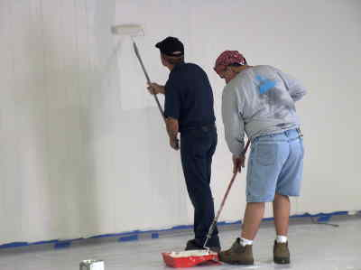 by: Submitted Photo - Texas volunteers paint at Madras First Baptist.