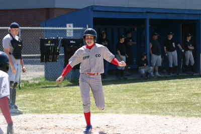 by: Photo By Holly Gill - Junior all-star Ryan Brunner jubilantly crosses home plate during a game this spring.