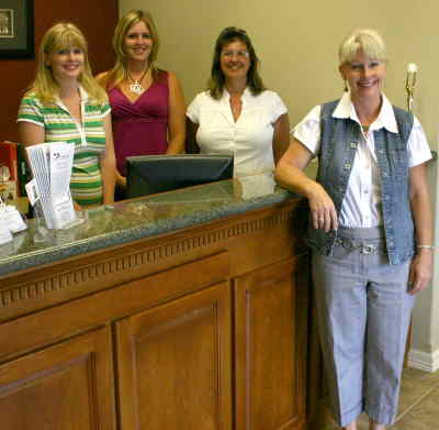 by: Photo By Susan Matheny - Delita's team in the new Century-21 Gold Country office, from left, brokers Shannon Hall and Holly Booren, secretary Amber Sanders, and owner Delita Cordes.