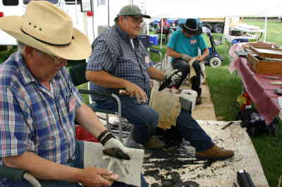 by: Photo By Susan Matheny - Rock knappers Ed Thomas of Goldendale, Wash., on left, Stuart Murdock of Redmond, and Emory Coons of Burns demonstrate their skills at knapping obsidian and other stones into knife blades, jewelry and arrowheads.
