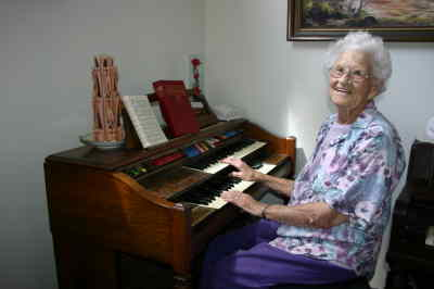by: Photo By Susan Matheny - Pioneer Queen Mildred Gladwill took lessons as a child and plays both the organ and piano.