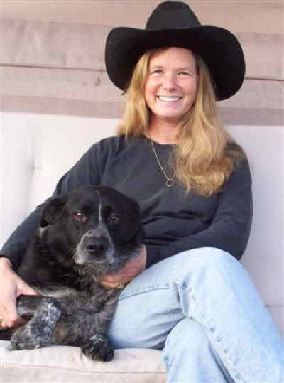 by: Submitted photo - Renée Zipser at home with her dog.
